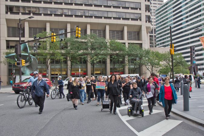 Women and allies marched in Center City Philadelphia as part of a national walkout to show support for Christine Blasey Ford and Deborah Ramirez, two women who claim Supreme Court Judge nominee Brett Kavanaugh assaulted them. (Kimberly Paynter/WHYY)