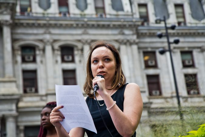 Emily Woods shares her experiences with rape and sexual assault as part of a national walkout to show support for Christine Blasey Ford and Deborah Ramirez, two women who claim Supreme Court Judge nominee Brett Kavanaugh assaulted them. (Kimberly Paynter/WHYY)