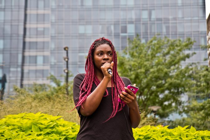 Blessing Osazuwa shares her experiences with rape and sexual assault as part of a national walkout to show support for Christine Blasey Ford and Deborah Ramirez, two women who claim Supreme Court Judge nominee Brett Kavanaugh assaulted them. (Kimberly Paynter/WHYY)