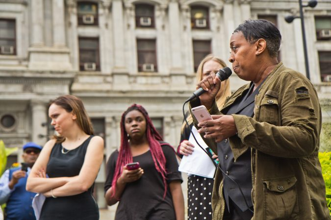 Tonya Bah shares her experiences with rape and sexual assault as part of a national walkout to show support for Christine Blasey Ford and Deborah Ramirez, two women who claim Supreme Court Judge nominee Brett Kavanaugh assaulted them. (Kimberly Paynter/WHYY)