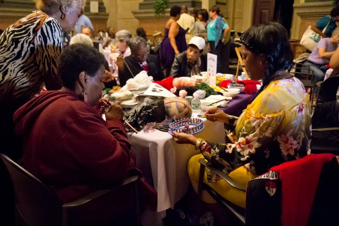 About 100 crocheters and knitters gathered at City Hall to create warm clothes for homeless people. (Kimberly Paynter/WHYY)