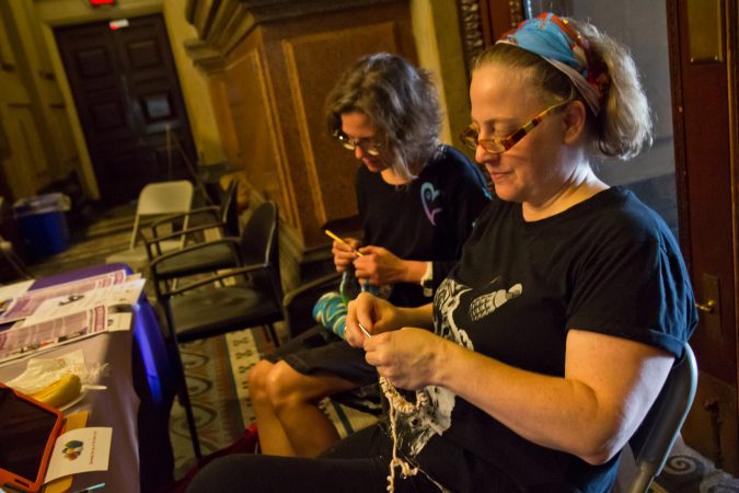 Samantha Osmer, (right), and Marcie Merz, (left) traveled into Philadelphia from Bucks Coutny to participate in the annual Knit In. (Kimberly Paynter/WHYY)