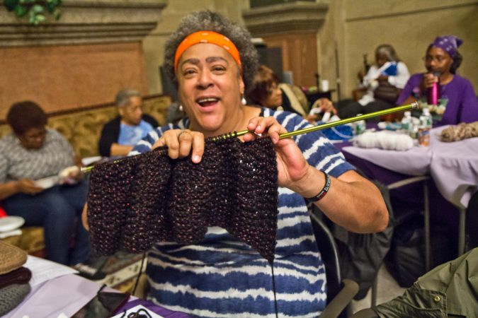 Julia Kent knits a prayer shawl at the annual Knit In. She often knits with other women at 62nd and Cedar in West Philadelphia called the Sunshine Group. (Kimberly Paynter/WHYY)