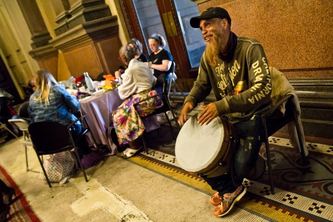 """Arnold """"Red Bonz"""" drums for the knitters at the annual Knit In at Philadelphia City Hall. (Kimberly Paynter/WHYY)"""