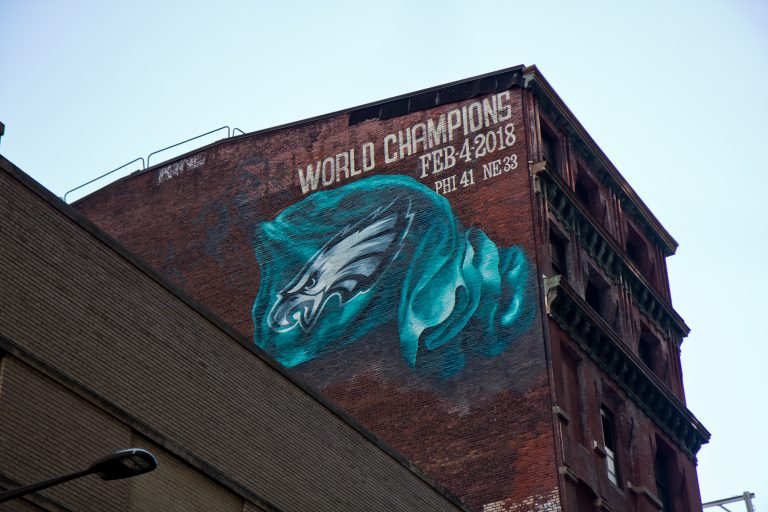 A mural commemorating the Eagles' Super Bowl win is being installed on Sansom Street between 13th and Broad streets in Center City Philadelphia. (Kimberly Paynter/WHYY)
