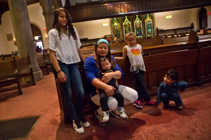 Suyapa Reyes and her children take sanctuary at the First United Methodist Church of Germantown. (Kimberly Paynter/WHYY)
