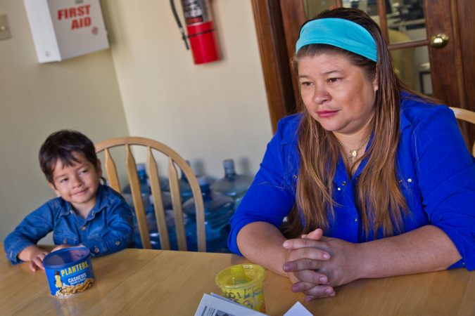 Suyapa Reyes moved to the U.S. from Honduras about five years ago. Her son Jeison, 2, was born in the and is a citizen. After receiving a deportation notice, Reyes and her son, and other children took sanctuary at the First United Methodist Church of Germantown. (Kimberly Paynter/WHYY)