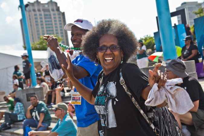 Shrila Smith, an Eagles fan and Brewerytown resident, dances when the Eagles win Super Bowl VII during a replay at Penn's Landing. (Kimberly Paynter/WHYY)
