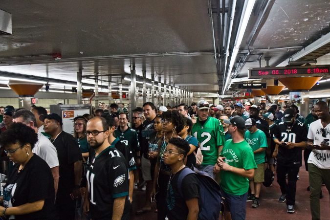 Eagles fans exit the subway and head to the season opener. (Kimberly Paynter/WHYY)