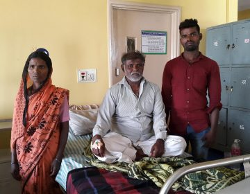 Sidlappa, who goes by one name, is 58 years old and waiting to get an angiogram. He traveled 8 hours to the hospital in Bangalore with his wife Ramlingamma and two of his seven children. (Mary-Rose Abraham)