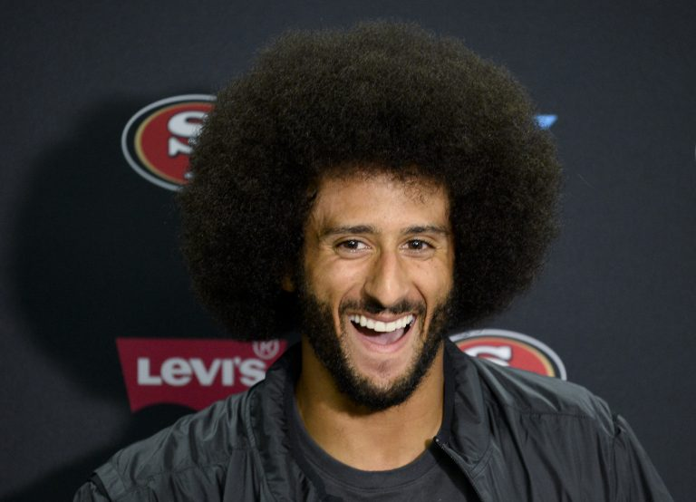 407cbab86c1 San Francisco 49ers quarterback Colin Kaepernick talks to the media at a  news conference an NFL