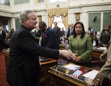 Philadelphia Mayor Jim Kenney shakes hands with members of City Council after speaking at City Hall in Philadelphia, Thursday, Nov. 2, 2017. (Matt Rourke/AP Photo)