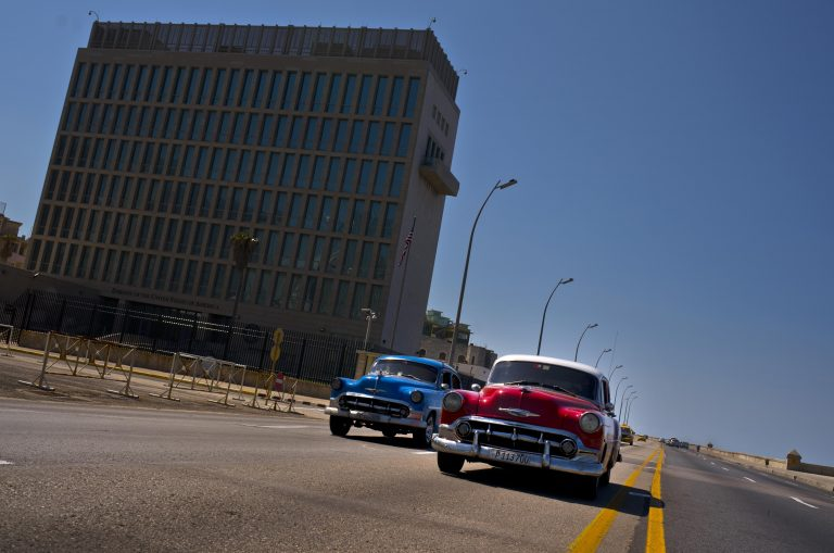 Cars drive passt the United States Embassy in Havana, Cuba, Friday, March 2, 2018. Citing mysterious
