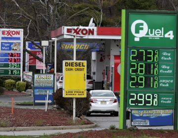 Gas stations display the price of gasoline in Englewood, N.J. (Seth Wenig/AP Photo)