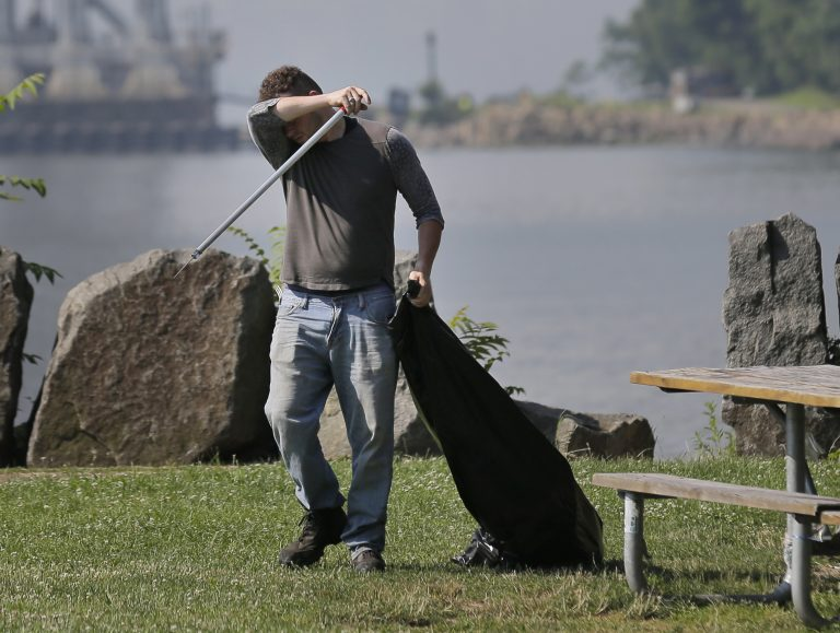 Robert Gidney wipes away sweat while working in Palisades Interstate Park in Ft. Lee, N.J., Monday, July 2, 2018. (Seth Wenig/AP Photo)