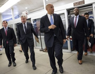 (From left), Sen. Richard Blumenthal, D-Conn., Sen. Sheldon Whitehouse, D-R.I., Sen. Cory Booker, D-N.J., and Sen. Tim Scott, R-S.C., arrive at the Capitol for a procedural vote on an appropriations measure, in Washington, Thursday, Aug. 23, 2018. (J. Scott Applewhite/AP Photo)