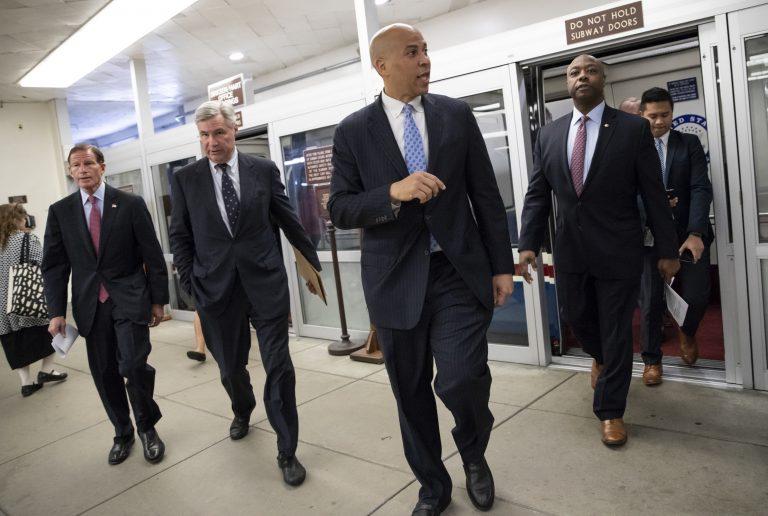 (From left), Sen. Richard Blumenthal, D-Conn., Sen. Sheldon Whitehouse, D-R.I., Sen. Cory Booker, D-N.J., and Sen. Tim Scott, R-S.C., arrive at the Capitol for a procedural vote on an appropriations measure, in Washington, Thursday, Aug. 23, 2018. (J. Scott Applewhite/AP Photo)