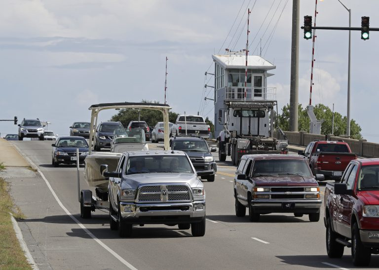 People drive over a drawbridge in Wrightsville Beach, N.C., as they evacuate the area in advance of Hurricane Florence, Tuesday, Sept. 11, 2018. Florence exploded into a potentially catastrophic hurricane Monday as it closed in on North and South Carolina, carrying winds up to 140 mph (220 kph) and water that could wreak havoc over a wide stretch of the eastern United States later this week. (AP Photo/Chuck Burton)