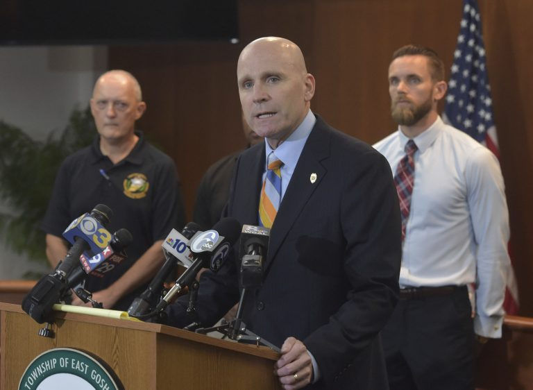 Chester County District Attorney Tom Hogan speaks about the shooting at Bellingham Retirement Community on East Boot Road in East Goshen Township, Pa., Wednesday, Sept. 19, 2018. Authorities are searching for a man who they say shot at his ex-wife and then killed his parents at the retirement center. Hogan says authorities are looking for 59-year-old Bruce Rogal of Glenmoore. (Pete Bannen/Daily Local News via AP)