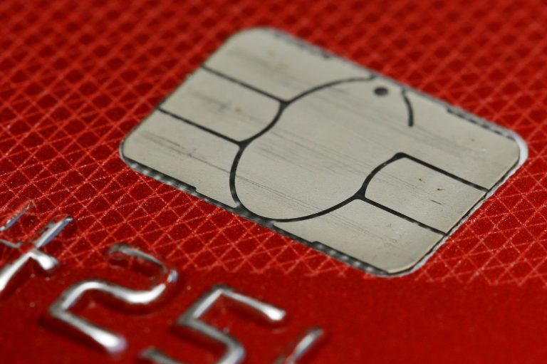 This June 10, 2015, file photo shows a chip credit card in Philadelphia. Consumers can now freeze their credit for free under a new federal law, which takes effect Friday, Sept. 21, 2018. A credit freeze restricts access to your credit file, essentially halting anyone from opening any new credit in your name. (Matt Rourke/AP Photo, File)