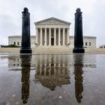The Supreme Court is seen in Washington, Sunday, Sept. 23, 2018. With the opening of the high court's new term approaching, President Trump is anxious for his Supreme Court nominee Brett Kavanaugh to be confirmed by the Senate. Attorneys for Brett Kavanaugh's accuser, Christine Blasey Ford, are citing