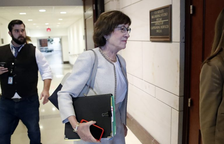 Sen. Susan Collins, R-Maine, center, walks on Capitol Hill, Monday, Sept. 24, 2018 in Washington. Her vote is considered crucial to getting Brett Kavanaugh confirmed to the U.S. Supreme Court. AP Photo/Alex Brandon)