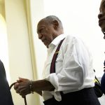Bill Cosby is taken away in handcuffs after he was sentenced to three-to 10-years for felony sexual assault on Tuesday, Sept. 25, 2018, in Norristown, Pa. (Mark Makela/Pool Photo via AP)