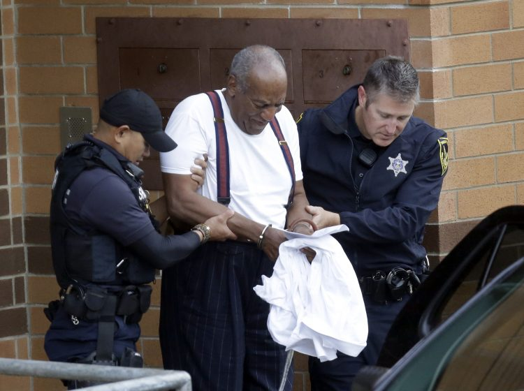 Bill Cosby is escorted out of the Montgomery County Correctional Facility, Tuesday Sept. 25, 2018, in Eagleville, Pa., following his sentencing to three-to-10-year prison sentence for sexual assault. (AP Photo/Jacqueline Larma)