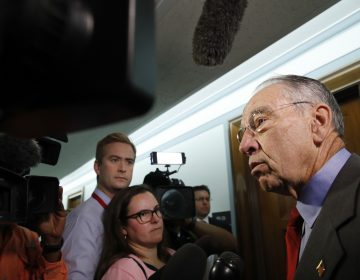 Sen. Chuck Grassley, R-Iowa, right, chair of the Senate Judiciary Committee, answers questions from reporters about allegations of sexual misconduct against Supreme Court nominee Brett Kavanaugh, Wednesday, Sept. 26, 2018, as he arrives for a Senate Finance Committee hearing on Capitol Hill in Washington. (AP Photo/Jacquelyn Martin)