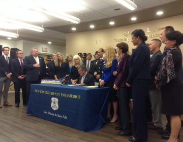 Gov. John Carney signed three bills aimed at addressing Delaware's opioid crisis. (Zoe Read/WHYY)