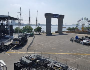 Workers set up up for the NFL Kickoff Experience at Penn's Landing, leading into the Eagles' home opener Thursday. (Sara Hoover for WHYY)