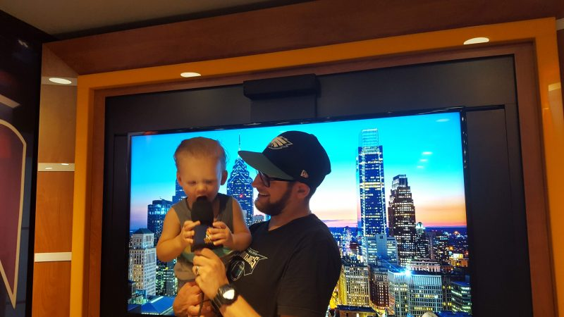 "Marco Lerro and his son, Bruno, check out the  ""Sunday Night Football on NBC"" tour bus. (Sara Hoover for WHYY)"