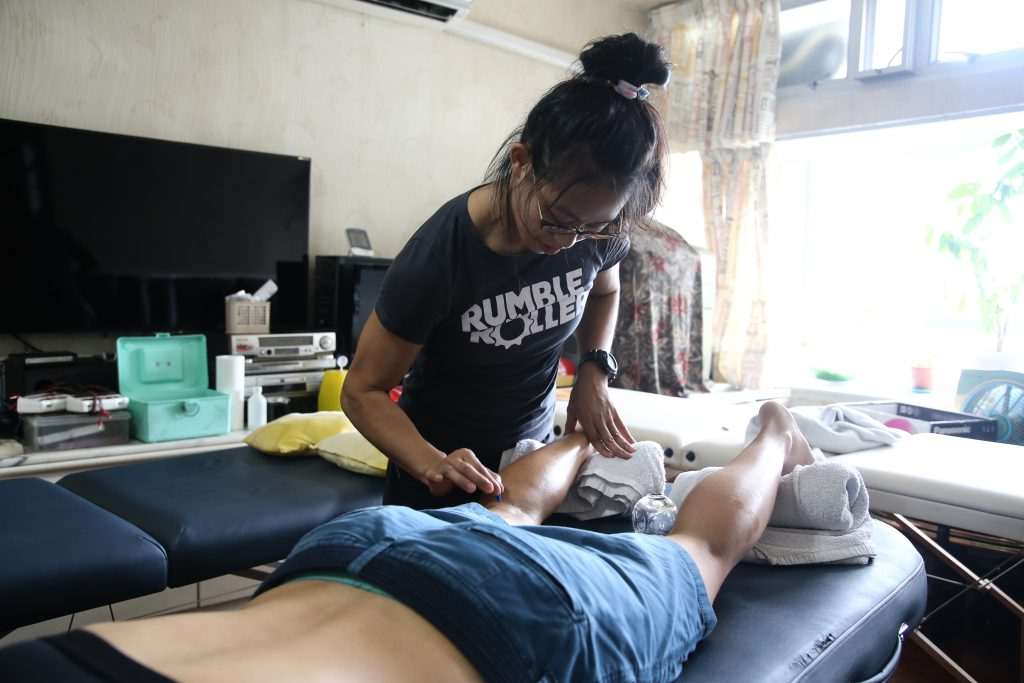Acupuncturist Toto Cheng treats one of her athlete clients. Quite a few elite athletes use Chinese medicine, including Olympic swimmer Michael Phelps. Credit: Li Tin-nok