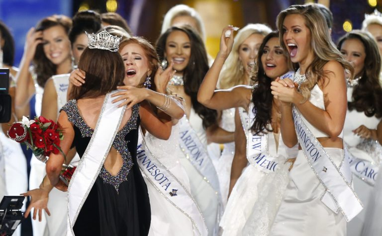 Miss North Dakota Cara Mund is congratulated by contestants after being named Miss America during Miss America 2018 pageant, Sunday, Sept. 10, 2017, in Atlantic City, N.J.