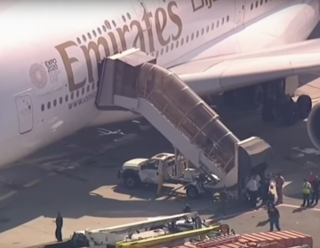 Plane lands at JFK with dozens of sick passengers (AP video)