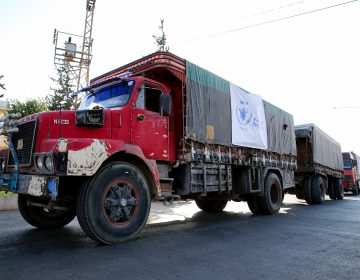 A World Food Programme convoy carries humanitarian aid to Aleppo, Syria. Getting food into conflict zones is a major hurdle — and a topic of discussion at the WFP's Innovation Accelerator. (Cem Genco/Anadolu Agency/Getty Images)