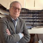 FILE - In this April 1991 file photo, architect Robert Venturi poses in his office in the Manayunk section of Philadelphia, with a model of a new hall for the Philadelphia Orchestra in background. Venturi, who turned austere modern design on its ear, ushering in postmodern complexity with the dictum