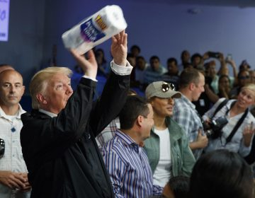President Trump tosses paper towels into a crowd in Puerto Rico after Hurricane Maria hit the island in 2017. (Evan Vucci/AP)