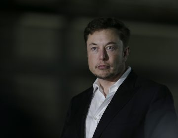 Tesla stocks tumbled this week after CEO Elon Musk appeared to smoke pot in a podcast, and top executives left the company. (Kiichiro Sato/AP)