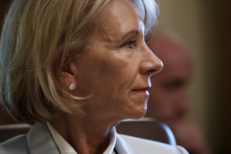 Secretary of Education Betsy DeVos listens as President Donald Trump speaks during a June 21 cabinet meeting at the White House in Washington. (Evan Vucci/AP)
