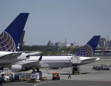 Workers at Newark Liberty International Airport are getting a wage boost starting Nov. 1, the Port Authority Board of Commissioners announced Thursday. (Julio Cortez/AP)