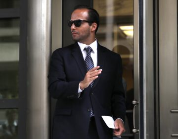 Former Trump campaign aide George Papadopoulos, whose actions triggered the Russia investigation, leaves federal court after he was sentenced to 14 days in prison on Friday. He had pleaded guilty to lying to the FBI. (Jacquelyn Martin/AP)