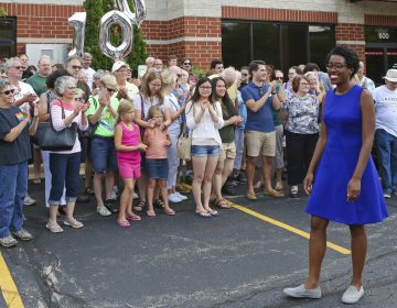 In this July 29, 2018, photo, rookie Democratic candidate Lauren Underwood greets supporters at the opening of her campaign office in St. Charles, Ill., 100 days before the midterm election. (Teresa Crawford/AP)