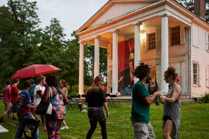Strawberry Mansion residents mingle on the lawn of the Hatfield House at an art and storytelling event hosted by Amber Art and Design in July. (Albert Yee for Fairmount Park Conservancy)