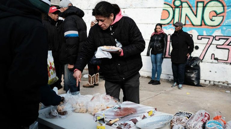 A local church distributes food and clothes to residents in need in the Kensington section in Philadelphia. (Spencer Platt/Getty Images)