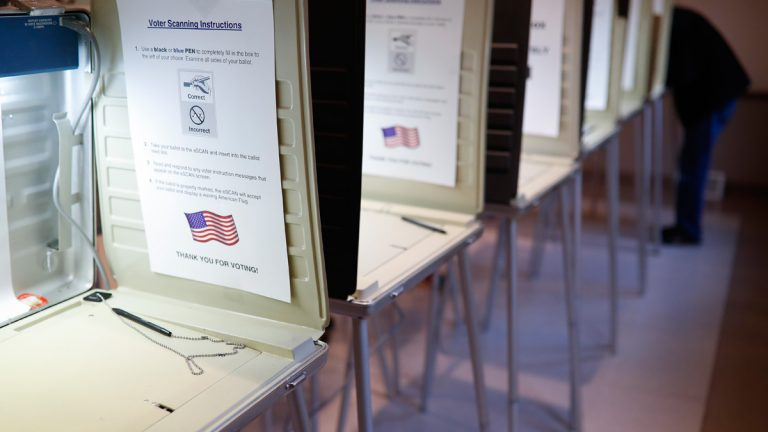 A row of empty booths at a polling station in the Terrace Park Community Building on Election Day in Cincinnati. (AP Photo/John Minchillo, File)
