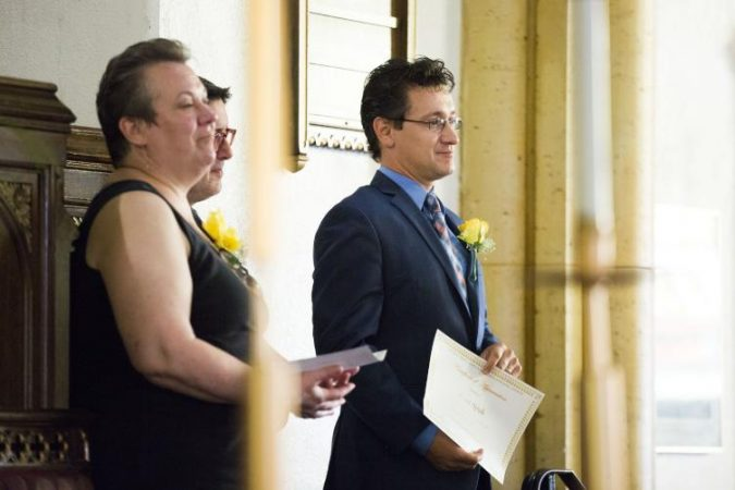(From left) Architect Kathy Dowdell, Ryan Spak of the University City District, and David Hincher of Cedar Park Neighbors are honored at Hickman Temple. (Rachel Wisniewski for WHYY)