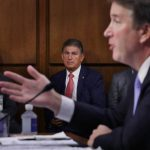 Sen. Joe Manchin, D-W.Va., listens to Supreme Court nominee Judge Brett Kavanaugh as he testifies before the Senate Judiciary Committee on Sept. 6. Running a tight reelection race in a conservative state, Manchin has faced pressure to support Kavanaugh.