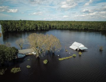 A flooded farm stands next to the Lumber River on Monday in this aerial photograph taken after Hurricane Florence hit Lumberton, N.C. (Charles Mostoller/Bloomberg /Bloomberg via Getty Images)