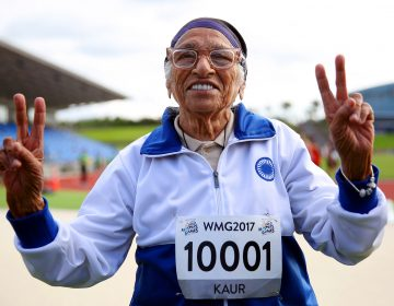 Man Kaur of India celebrates after competing in the 100-meter sprint in the 100+ age category at the World Masters Games in Auckland, New Zealand, in April 2017. (Michael Bradley/AFP/Getty Images)
